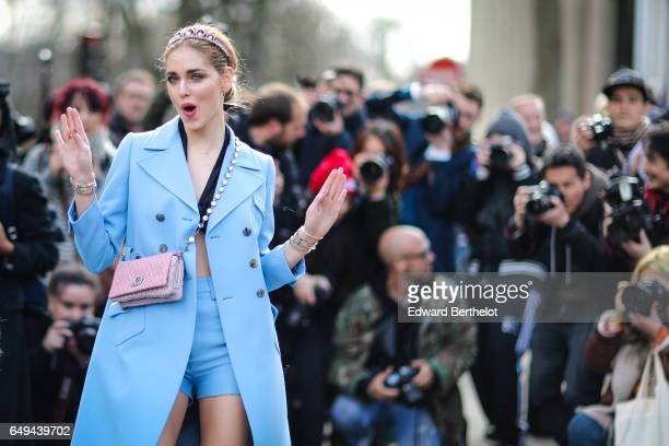 Chiara Ferragni wears a blue coat and a pink bag outside the Miu Miu show during Paris Fashion Week Womenswear Fall/Winter 2017/2018 on March 7 2017...