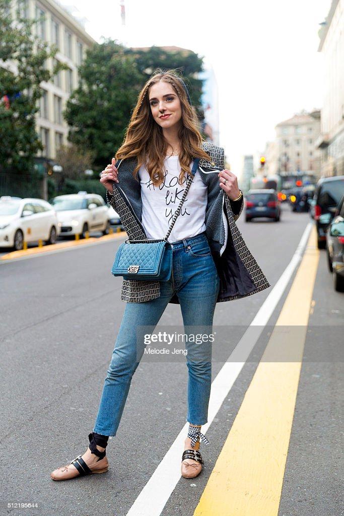 Chiara Ferragni wears a Fendi logo print blazer a #looklikeyou tshirt and Chanel purse at the Alberta Ferretti show on February 24 2016 in Milan Italy