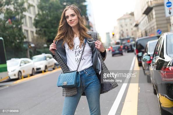 Chiara Ferragni wears a Fendi logo print blazer a #looklikeyou tshirt and Chanel purse at the Alberta Ferretti show on February 24 2016 in Milan Italy
