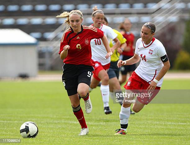 Chiara Loos of Germany battles for the ball with Katarzyna Grzywinska of Poland during the U15 Women International Friendly match between Poland and...
