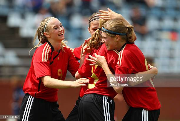 Chiara Loos of Germany celebrates with her team mates Saskia Matheis and Rebecca Knaak during the U15 Women International Friendly match between...