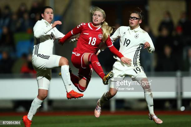 Chiara Marie Hahn and Julia Pollak of Germany and Mathilde Rasmussen of Denmark compete for the ball during the U16 Girls international friendly...