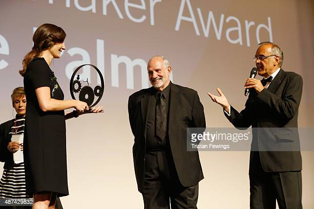 Chiara Mastroianni and Brian De Palma on stage with their awards and Venice Film Festival director Alberto Barbera at the JaegerLeCoultre Glory to...