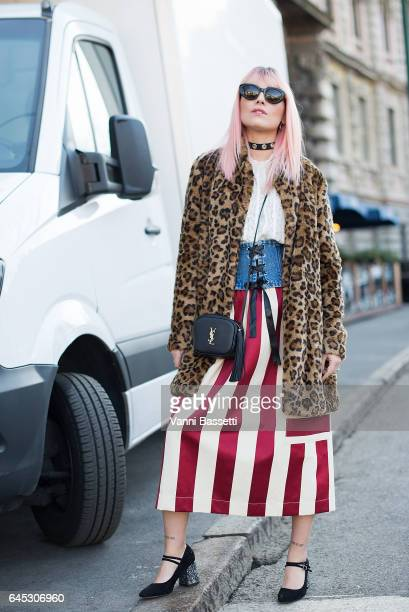 Chiara Monteleone poses with an YSL bag before the Jil Sander show during Milan Fashion Week Fall/Winter 2017/18 on February 25 2017 in Milan Italy
