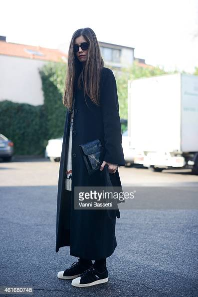 Chiara Noto poses wearing Adidas shoes and dries Van Noten clutch on January 17 2015 in Milan Italy