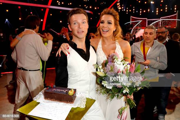 Chiara Ohoven and Vadim Garbuzov pose with Chiara's birthday cake after the 1st show of the tenth season of the television competition 'Let's Dance'...