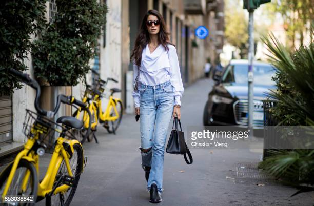 Chiara Totire wearing white blouse denim jeans is seen outside Dolce Gabbana during Milan Fashion Week Spring/Summer 2018 on September 24 2017 in...