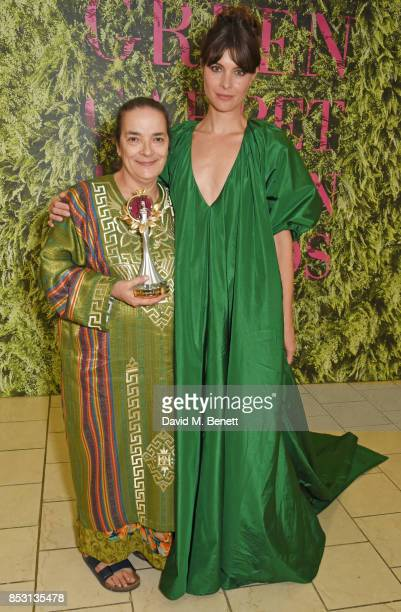 Chiara Vigo winner of The Artisanal Laureate Award poses backstage with presenter Vittoria Puccini at The Green Carpet Fashion Awards Italia at...