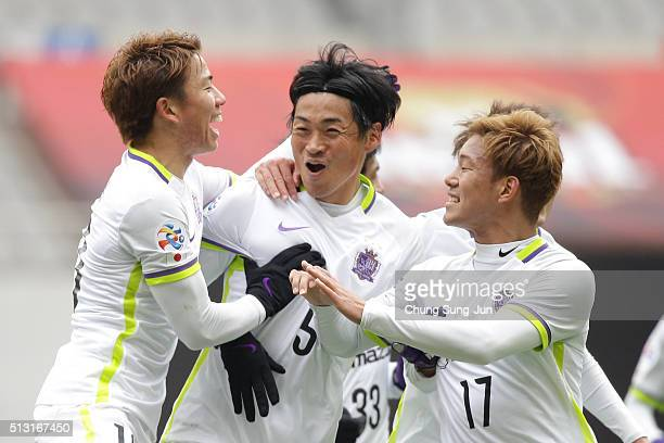 Chiba Kazuhiko of Sanfrecce Hiroshima celebrates with teammates after a score during the AFC Champion League Group F match between FC Seoul and...