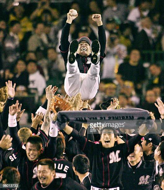 Chiba Lotte Marines manager Bobby Valentine and former New York Mets manager is tossed into the air after their 32 victory over the Hanshin Tigers in...