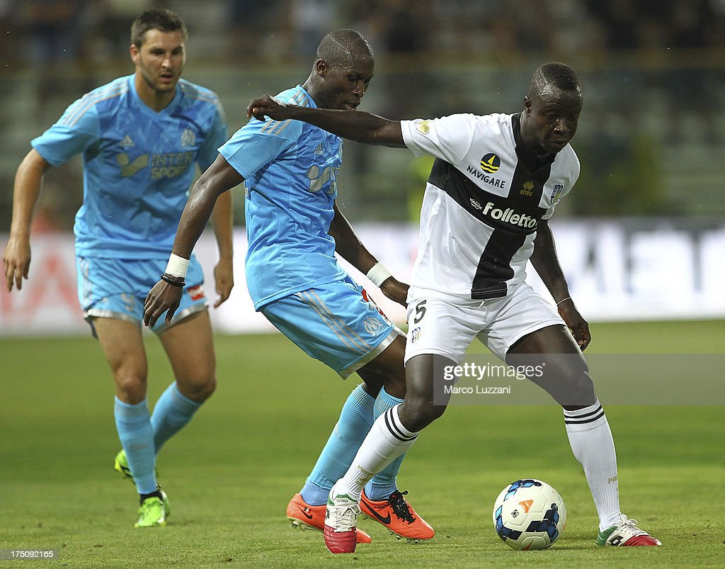 Chibsah Yussif Raman of Parma FC competes for the ball with Rod Fanni of Olympique de Marseille during the preseason friendly match between Parma FC...