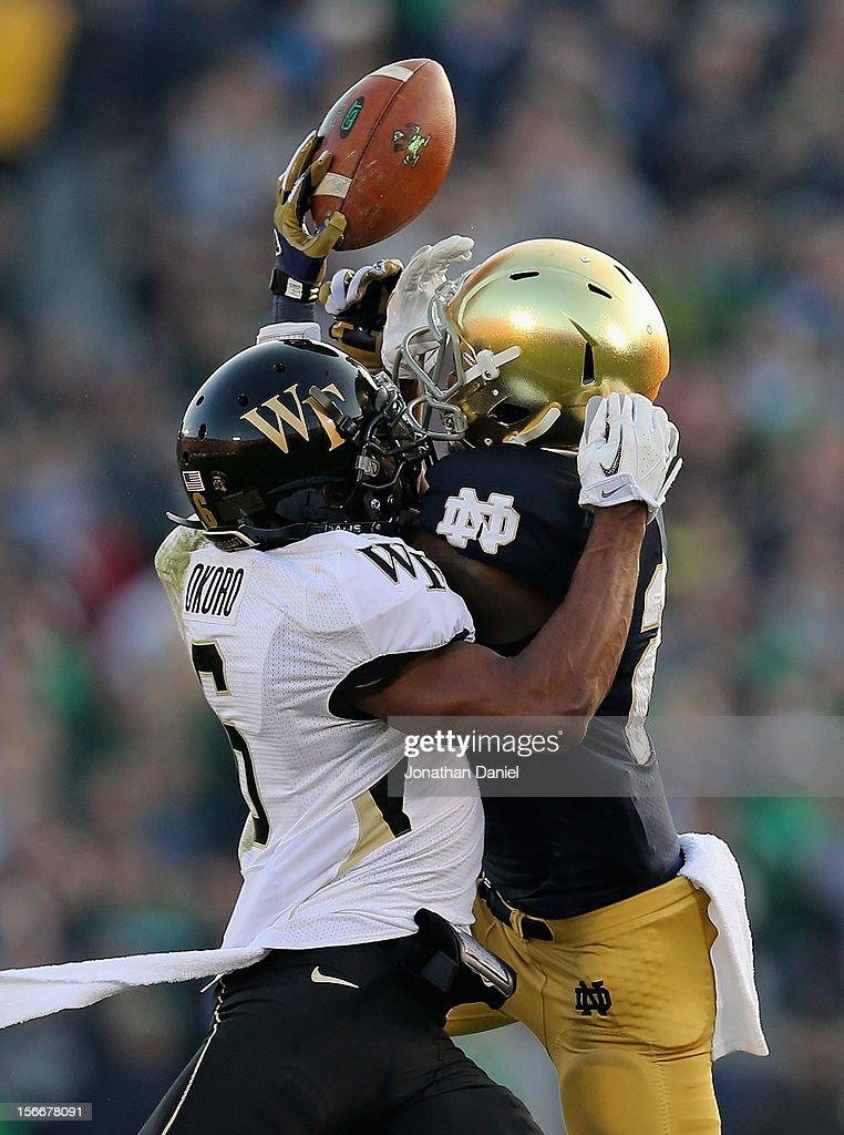 Chibuikem Okoro of the Wake Forest Demon Deacons breaks up a pass intended for Chris Brown of the Notre Dame Fighting Irish at Notre Dame Stadium on...
