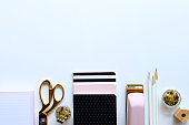 Chic pink, white, black and gold styled desktop framing white copy space.
