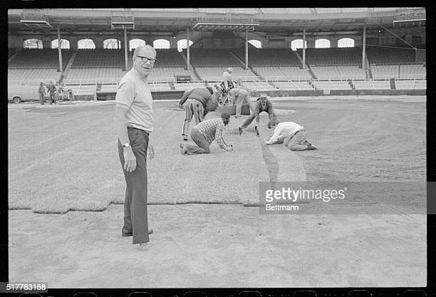 A return to the good earth Chicago White Sox owner Bill Veeck watches as sod is laid on infield at Sox Park 3/26 After purchasing the Sox Veeck...