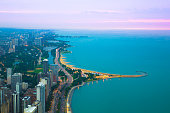 View of Chicago Illinois and Lake Michigan with beaches, buildings and roads in view at sunset