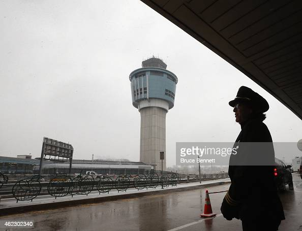 Chicago based pilot Nancy Kaney checks out the weather conditions after her flight was cancelled at Laguardia Airport on January 26 2015 in New York...