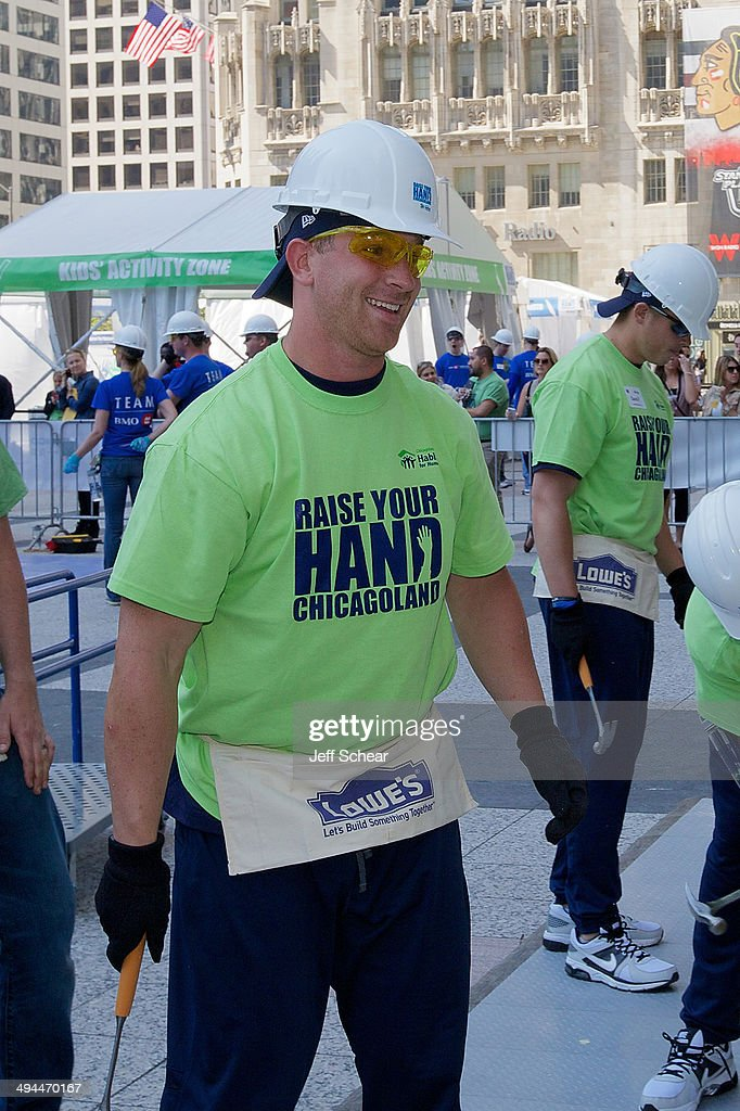 Chicago Bear <a gi-track='captionPersonalityLinkClicked' href=/galleries/search?phrase=Jordan+Lynch&family=editorial&specificpeople=7377245 ng-click='$event.stopPropagation()'>Jordan Lynch</a> helps kick off Habitat for Humanity's 'Raise Your Hand Chicagoland,' an unprecedented building blitz in the heart of downtown Chicago. From May 29 through June 1 at Pioneer Court Plaza, volunteers will come together with partner families to complete the initial construction of 13 homes. Immediately following, these new homes will be taken into communities across the region, where they will be finished and become a place 13 families can call their own. Those across the area are invited to attend 'Raise Your Hand Chicagoland' to tour a Habitat home, participate in family-friendly activities and learn more about Habitat for Humanity in Chicagoland, including future volunteer opportunities. Chicagoans can also show their support virtually using #RYHC and following Habitat for Humanity on Facebook, Twitter and Instagram (@ChicagoHabitat). For more information, visit chicagolandhabitat.org/RYHC.