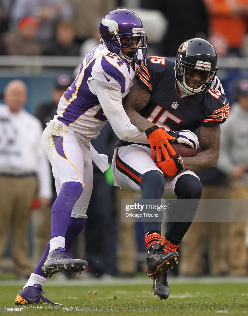 Chicago Bears' Brandon Marshall catches a pass as Minnesota Vikings' AJ Jefferson defends during 4th quarter at Solider Field on Sunday, November 25, 2012, in Chicago, Illinois. The Bears defeated the Vikings, 28-10.