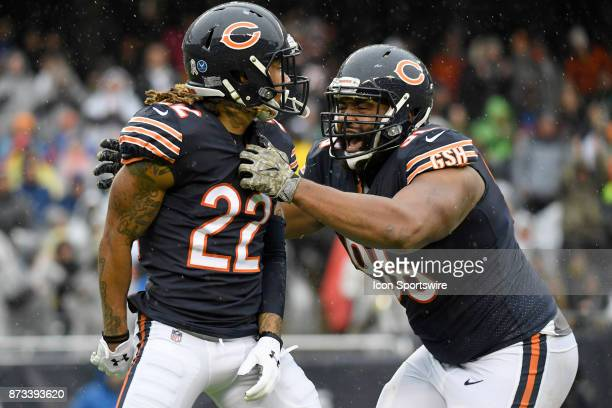Chicago Bears cornerback Cre'von LeBlanc celebrates with Chicago Bears defensive end Akiem Hicks after a tackle during an NFL football game between...