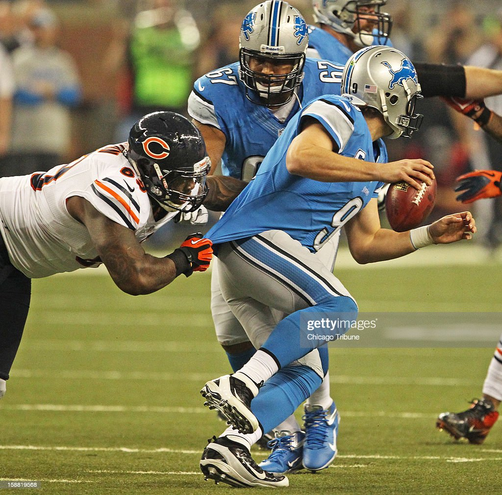 Chicago Bears defensive tackle Henry Melton (69) grabs hold of Detroit Lions quarterback Matthew Stafford during the first quarter of their game at Ford Field in Detroit, Michigan, Sunday December 30, 2012. The Chicago Bears beat the Detroit Lions, 26-24.