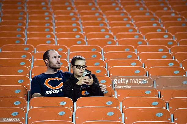 Chicago Bears fan and a Cleveland Browns fan wait out the end of the game during the fourth quarter at FirstEnergy Stadium during a preseason game on...