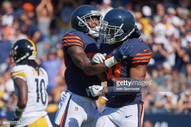 Chicago Bears free safety Eddie Jackson and Chicago Bears cornerback Marcus Cooper celebrate after a play during an NFL football game between the...