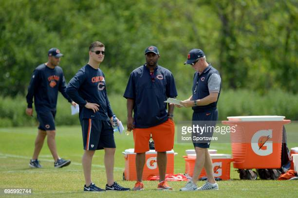 Chicago Bears head coach John Fox and Chicago Bears General Manager Ryan Pace discuss practice material during the Bears minicamp workouts on June 14...