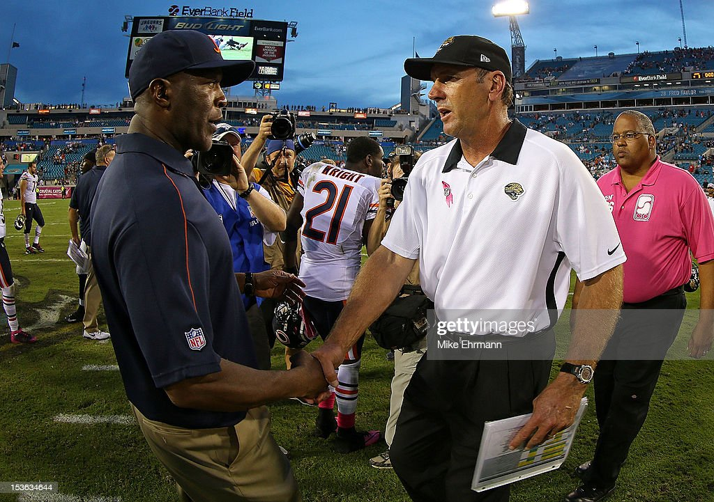 Chicago Bears head coach Lovie Smith shakes hands with Jacksonville Jaguars head coach Mike Mularkey following a game against the Jacksonville Jaguars at EverBank Field on October 7, 2012 in Jacksonville, Florida.