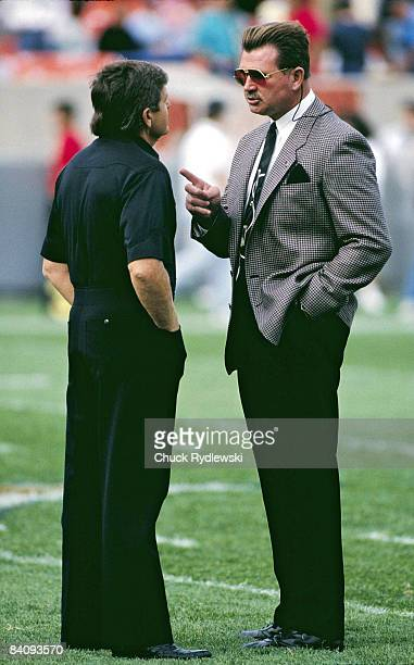 Chicago Bears Head Coach Mike Ditka confers with Houston Oilers Head Coach Jerry Glanville prior to their 1989 game at Soldier Field in Chicago...