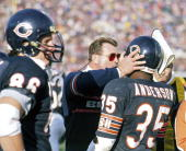 Chicago Bears Head Coach Mike Ditka talks to RB Neal Anderson during a 1992 game against the Green Bay Packers at Soldier Field in Chicago Illinois