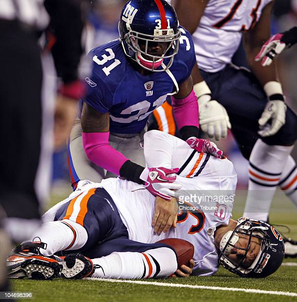 Chicago Bears' Jay Cutler sustains a concussion on a sack by New York Giants' Aaron Ross in the second quarter at New Meadowlands Stadium in East...