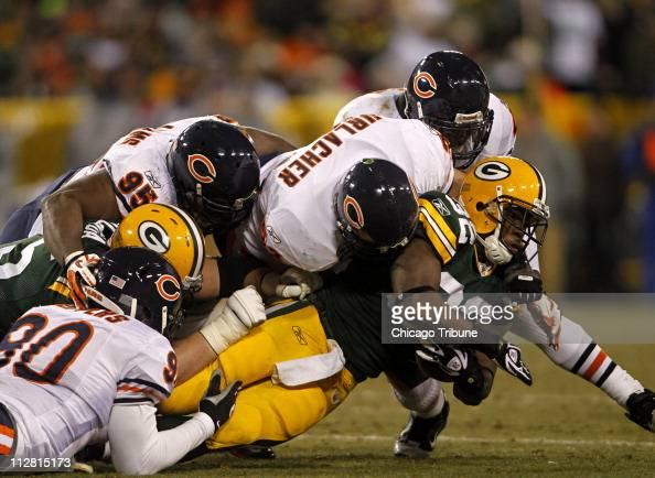 Chicago Bears linebacker Brian Urlacher and the Bears tackle Green Bay Packers running back Brandon Jackson in the third quarter The Packers defeated...