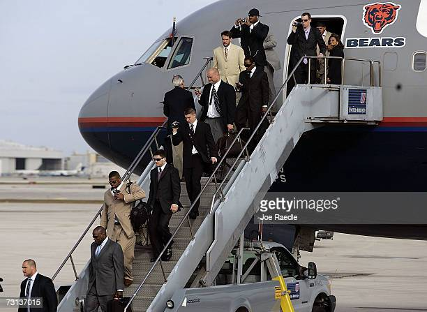 Chicago Bears players Fred Miller Rex Grossman Todd Johnson and John Tait and others arrive at Miami International Airport on a United airlines...