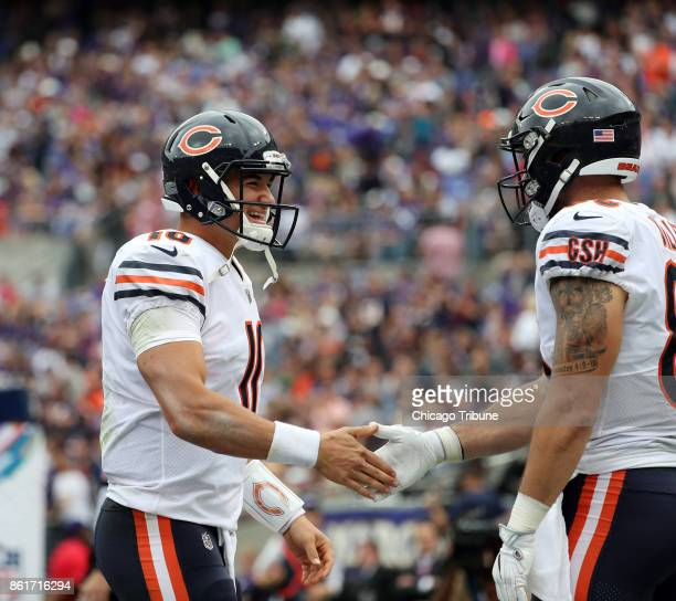 Chicago Bears quarterback Mitch Trubisky celebrates a touchdown by tight end Zach Miller in the second quarter against the Baltimore Ravens on Sunday...