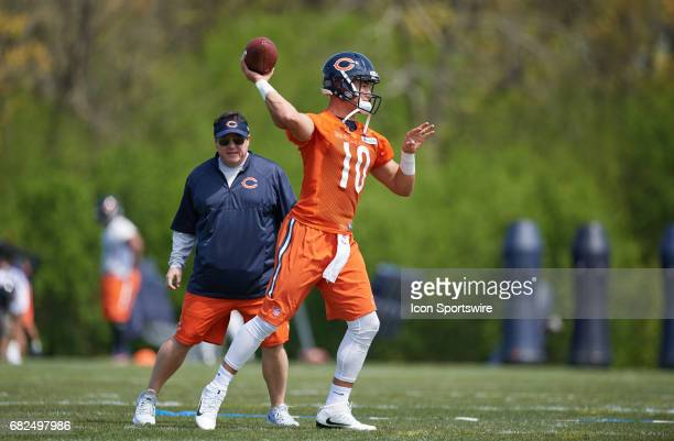 Chicago Bears quarterback Mitch Trubisky is coached by Chicago Bears offensive coordinator Dowell Loggains for a passing drill during the Chicago...