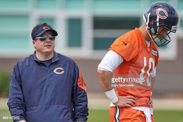 Chicago Bears quarterback Mitch Trubisky is coached by Chicago Bears offensive coordinator Dowell Loggains in a passing drill during the Chicago...