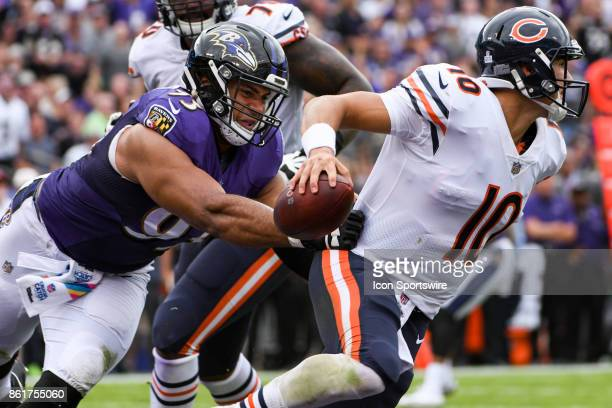 Chicago Bears quarterback Mitchell Trubisky gets away from the grasp of Baltimore Ravens defensive end Chris Wormley on October 15 at MT Bank Stadium...