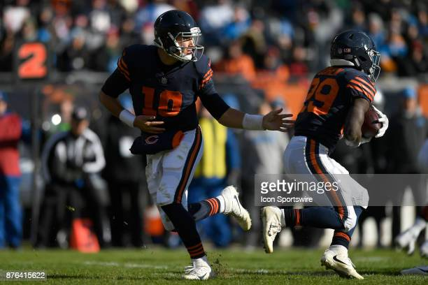 Chicago Bears quarterback Mitchell Trubisky hands the football to Chicago Bears running back Tarik Cohen during an NFL football game between the...