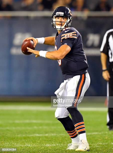 Chicago Bears quarterback Mitchell Trubisky looks down the field to pass the football during the preseason game between the Denver Broncos and the...