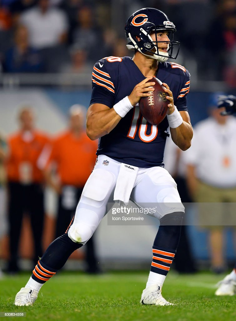 Chicago Bears quarterback Mitchell Trubisky (10) looks for a receiver during the preseason game between the Denver Broncos and the Chicago Bears on August 10, 2017 at Soldier Field in Chicago, Illinois.