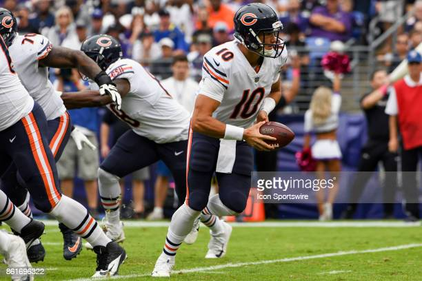 Chicago Bears quarterback Mitchell Trubisky looks to hand off in the first quarter against the Baltimore Ravens on October 15 at MT Bank Stadium in...