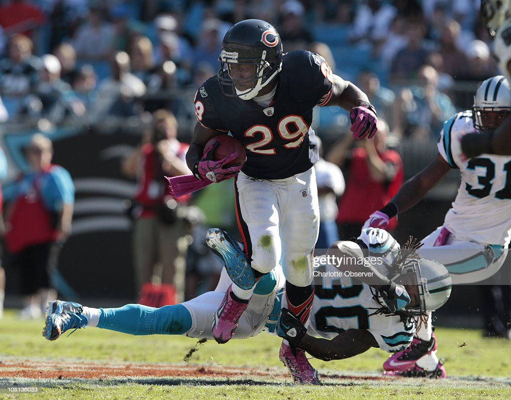 Chicago Bears running back Chester Taylor escapes Carolina Panthers Charles Godfrey during the fourth quarter at Bank of America Stadium in Charlotte, North Carolina, Sunday, October 10, 2010.