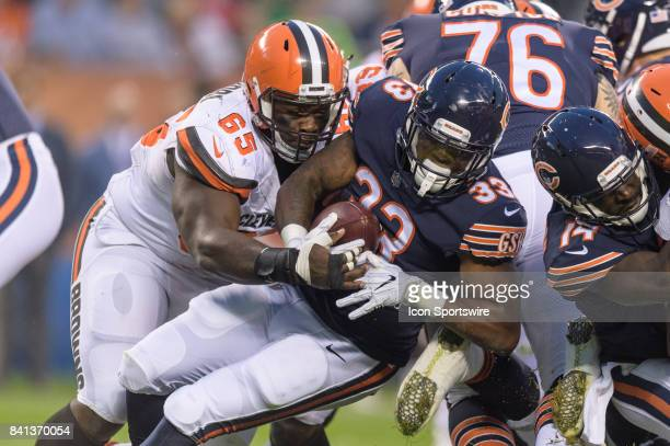 Chicago Bears running back Jeremy Langford runs the ball and is tackled by Cleveland Browns defensive lineman Larry Ogunjobi in the 1st quarter...
