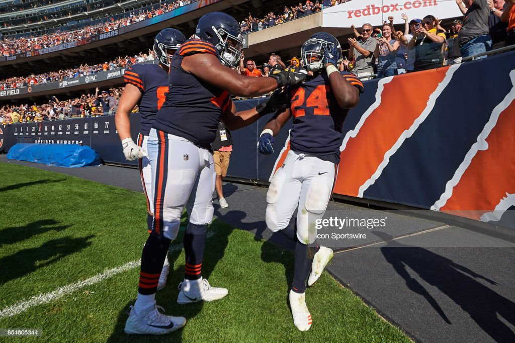 Chicago Bears running back Jordan Howard (24) celebrates with teammates after scoring the winning touchdown in overtime of an NFL football game between the Pittsburgh Steelers and the Chicago Bears on September 24, 2017 at Soldier Field in Chicago, IL.