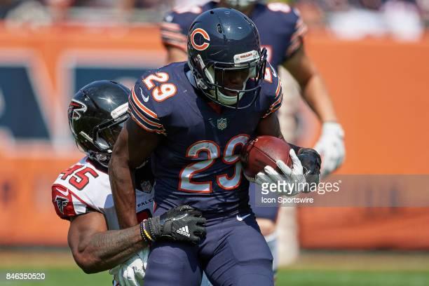 Chicago Bears running back Tarik Cohen battles with Atlanta Falcons middle linebacker Deion Jones during an NFL football game between the Atlanta...