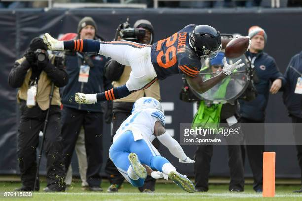 Chicago Bears running back Tarik Cohen dives into the endzone for a touchdoown over Detroit Lions free safety Glover Quin in the fourth quarter...