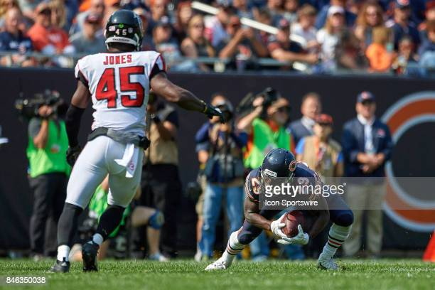 Chicago Bears running back Tarik Cohen dives to catch the football during an NFL football game between the Atlanta Falcons and the Chicago Bears on...