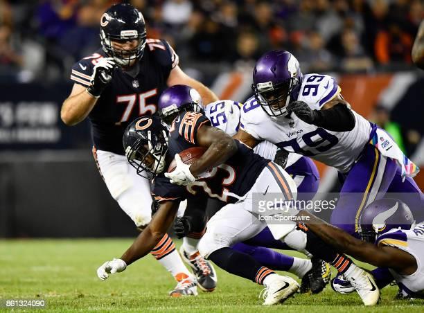 Chicago Bears running back Tarik Cohen is tacked by Minnesota Vikings outside linebacker Anthony Barr and Minnesota Vikings defensive end Danielle...