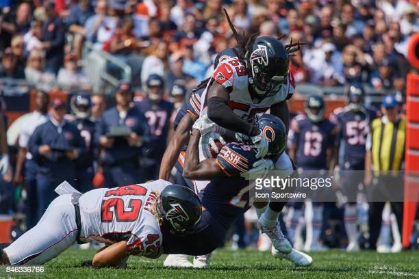 Chicago Bears running back Tarik Cohen is tackled by Atlanta Falcons outside linebacker Duke Riley and Atlanta Falcons outside linebacker De'Vondre...