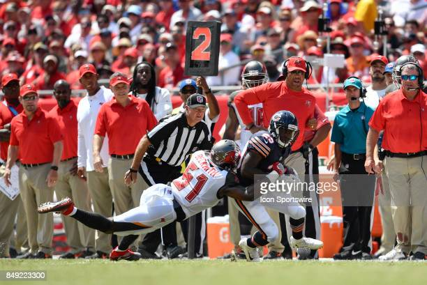 Chicago Bears running back Tarik Cohen is tackled by Tampa Bay Buccaneers linebacker Kendell Beckwith during an NFL football game between the Chicago...